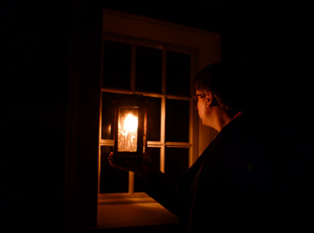 Ghost tour guide with lantern